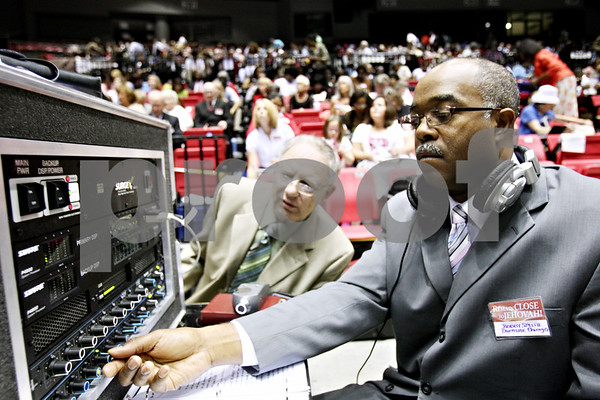 Rob Winner – rwinner@daily-chronicle.com<br /> <br /> Robby Smith, of Chicago, controls the sound system as the Jehovah's Witness convention begins at the Convocation Center in DeKalb, Ill. on Friday June 18, 2010.