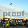 Emergency medical personnel help victims at the scene of a mock crash involving a drunk driver Thursday as a Flight for Life helicopter prepares to land nearby.<br /> <br /> Nicole Weskerna nweskerna@daily-chronicle.com