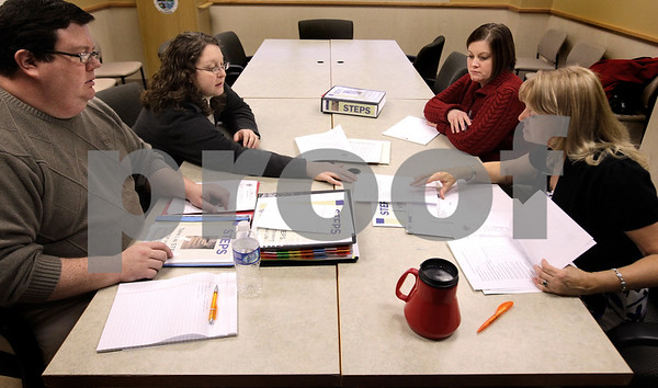 "Kyle Bursaw – kbursaw@daily-chronicle.com<br /> <br /> Probation officers, from left, Adam Christiansen, Tammy Wilkinson, Amber Hiland and Denise Pope discuss the STEPS program in a meeting. The program's mission is to ""Increase the number of clients who successfully complete probation, reduce technical violations and reduce future recidivism, in Sycamore, Ill. on Wednesday, Dec. 1, 2010."