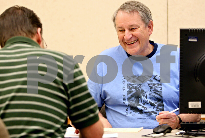 Rob Winner – rwinner@daily-chronicle.com<br /> <br /> Election judge John Linderoth (right) helps voter Eric Johnson, of DeKalb, at the DeKalb County Legislative Center in Sycamore, Ill. on Tuesday October 12, 2010.
