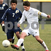 Kyle Bursaw - kbursaw@daily-chronicle.com<br /> <br /> Kaneland's Alex Gil tries to outmaneuver Sterling's Salomon Ocampo. The Knights fell 3-2 to Sterling in triple overtime. 10.26.10