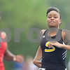 Lake Kwaza reacts after her the 100 meter dash Friday at the Class 2A State Track Meet in Charleston.