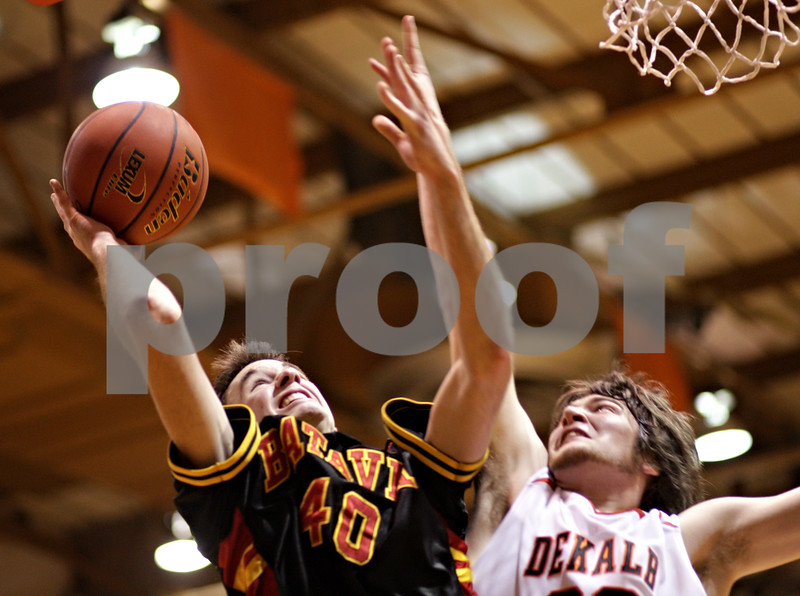 Beck Diefenbach  -  bdiefenbach@daily-chronicle.com<br /> <br /> Batavia's Levi Maxey (40, left) goes up against DeKalb's Jake Jouris (32) during the second quarter of the game at DeKalb High School in DeKalb, Ill., on Tuesday Jan. 26, 2010.
