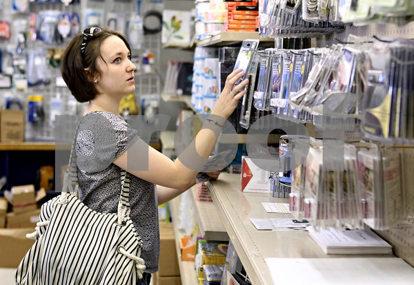 Rob Winner – rwinner@daily-chronicle.com<br /> <br /> First semester Northern Illinois University graduate student Megan McGrath, of Valparaiso, Indiana, looks for a memory drive while shopping at Village Commons Bookstore in DeKalb, Ill. on Friday August 6, 2010.