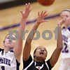 Beck Diefenbach  -  bdiefenbach@daily-chronicle.com<br /> <br /> DeKalb's Michelle Tood (3, right) shoots the ball next to Hampshire's Alex Dumoulin (31, left) during the second quarter of the IHSA Class 3A Regional championship game at Rochelle Township High School in Rochelle, Ill., on Thursday Feb. 18, 2010.