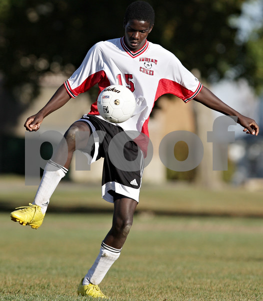 Rob Winner – rwinner@daily-chronicle.com<br /> <br /> Indian Creek's Shaq Crayton controls a ball during the first half of the regional quarterfinal game against Byron in Waterman, Ill. on Wednesday October 13, 2010. Indian Creek went on to defeat Byron, 2-1, in double overtime.