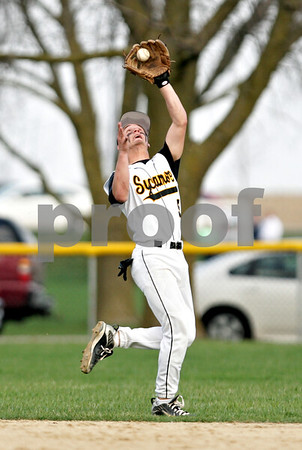 Beck Diefenbach  -  bdiefenbach@daily-chronicle.com<br /> <br /> Sycamore's Eric Ray (5) catches a pop fly during the top of the sixth inning of the game against DeKalb at Sycamore Park in Sycamore, Ill., on Tuesday April 6, 2010.