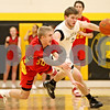 Rob Winner – rwinner@daily-chronicle.com<br /> Batavia's Elliott Vaughn knocks the ball away from Sycamore's Joe Strack during the second quarter. Batavia defeated Sycamore on Friday February 19, 2010 in Sycamore, Ill., 68-63.