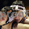 Beck Diefenbach  -  bdiefenbach@daily-chronicle.com<br /> <br /> DeKalb's Dalton Waite (right) keeps Sandwich's Sam Hill down during the 152 pound match at DeKalb High School in DeKalb, Ill., on Thursday Jan. 28, 2010. Waite beat Hill, helping DeKalb defeat Sandwich 37 to 27.