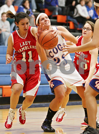 Rob Winner – rwinner@daily-chronicle.com<br /> <br /> Genoa-Kingston guard Karlie Fisher (23) is fouled by Mooseheart's Maria Dillon (11) during the first quarter in Genoa on Wednesday night.