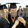 Rob Winner – rwinner@daily-chronicle.com<br /> <br /> DeKalb High School graduating seniors Jasmin Rabidoux and Chris Shearer look at a photograph that they snapped of themselves before their commencement ceremony at the Convocation Center in DeKalb, Ill. on Saturday June 6, 2010.