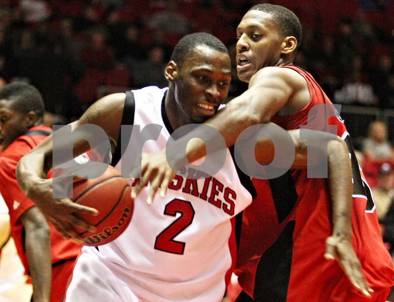 Rob Winner – rwinner@daily-chronicle.com<br /> Northern's Najul Ervin (left) looks to move past Ball State forward Jarrod Jones during the first half of their game on Saturday February 13, 2010 in DeKalb, Ill. Ball State defeated NIU, 71-66.