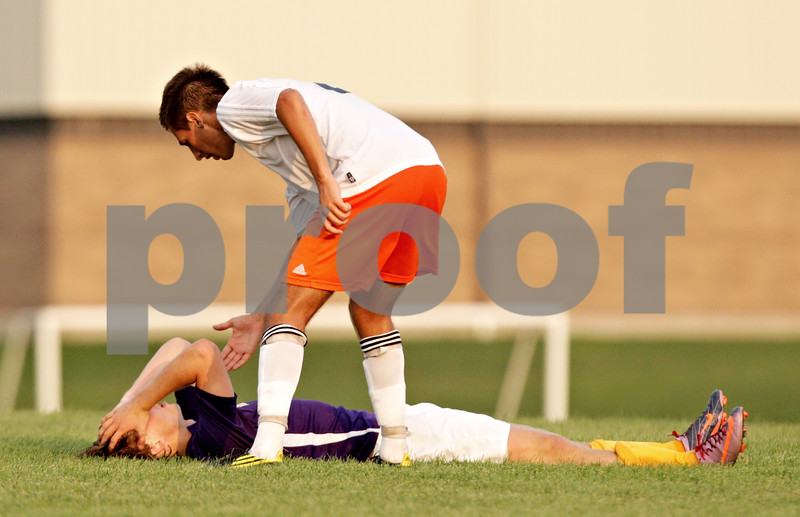 Beck Diefenbach - bdiefenbach@daily-chronicle.com<br /> <br /> DeKalb's Joe Ferguson (8, top) offers a hand after Hononegah Ryan Reid (15) collapses after missing a penalty kick during the second half of the game at DeKalb High School in DeKalb, Ill., on Tuesday Aug. 24, 2010. DeKalb and Hononegah tied 1 to 1.