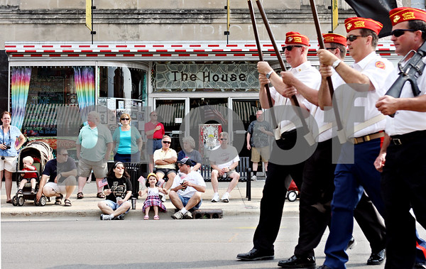 Rob Winner – rwinner@daily-chronicle.com<br /> <br /> Parade watchers line up along Lincoln Highway as the Memorial Day parade begins on Monday May 31, 2010 in DeKalb, Ill.