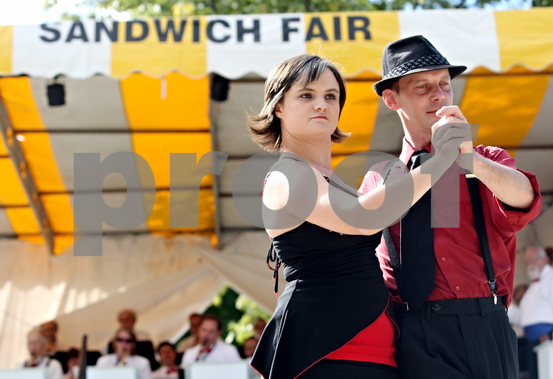Rob Winner – rwinner@daily-chronicle.com<br /> <br /> Amanda Summers (left) and Jeffrey Mosher dance while the Talk of the Town band performs at the Ag Land Stage during the Sandwich Fair in Sandwich, Ill. on Friday September 10, 2010.