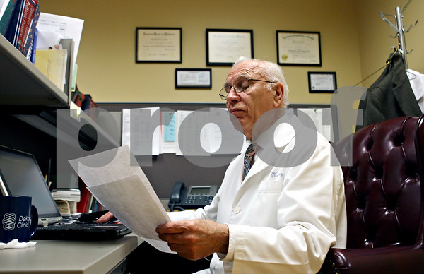 Rob Winner – rwinner@daily-chronicle.com<br /> <br /> Spotlight on Dr. John M. Kostrey
