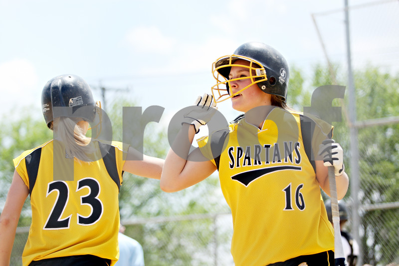 Rob Winner – rwinner@daily-chronicle.com<br /> <br /> Sycamore's Emily Schramer (23) congratulates teammate Nicole Schroeder after scoring in the fifth inning of the IHSA Class 3A Sycamore Regional championship game on Saturday May 29, 2010 in Sycamore, Ill. Sycamore went on to defeat Kaneland, 6-3.