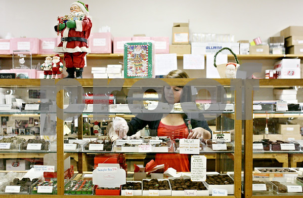 Rob Winner – rwinner@daily-chronicle.com<br /> <br /> Jodi Wright chooses chocolates for a pre-assorted gift box at The Confectionary on Tuesday night in Sycamore for last minute shoppers.