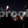 Beck Diefenbach  -  bdiefenbach@daily-chronicle.com<br /> <br /> A member of the Northern Illinois community raises her candle at the end of the candlelight vigil at the Martin Luther King Commons on the campus of NIU in DeKalb, Ill., on Sunday Feb. 14, 2010.
