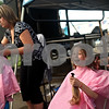 Beck Diefenbach  -  bdiefenbach@daily-chronicle.com<br /> <br /> Trinity Nordbrock (right), 7, reacts after being handed her severed hair at Relay for Life at Sycamore Park in Sycamore, Ill., on Friday June 18, 2010. Nordbrock's hair will be donated to Pantene Beautiful Lengths to be made into a wig for cancer patients.
