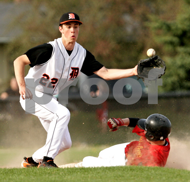 Beck Diefenbach  -  bdiefenbach@daily-chronicle.com<br /> <br /> DeKalb's Brian Sisler (22, left) cannot stop the ball at second base as Batavia's Braden Hrack (20) slides safe into second base during the third inning of the game at DeKalb High School in DeKalb, Ill., on Thursday April 15, 2010. Batavia defeated DeKalb 7 to 4.
