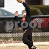 Beck Diefenbach  -  bdiefenbach@daily-chronicle.com<br /> <br /> DeKalb's Travis Jones catches a fly ball in the outfield during practice at DeKalb High School in DeKalb, Ill., on Monday March 15, 2010.