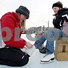 Rob Winner – rwinner@daily-chronicle.com<br /> Eileen Routson (left) helps Brooke Sunderlage, 9, put on a pair of ice skates while visiting the Genoa Community Ice Rink in Genoa, Ill on Saturday January 30, 2010.