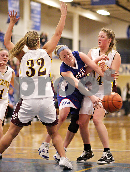 Beck Diefenbach  -  bdiefenbach@daily-chronicle.com<br /> <br /> Hinckley-Big Rock's Jess Thorp (center) passes the ball between Stockton's Morgan Werkheiser (32, left) and Haley Magee (24, right) during the third quarter of the IHSA Class 1A Super Sectional championship game at Judson University in Elgin, Ill., on Monday Feb. 22, 2010.