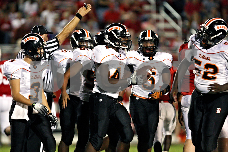 Rob Winner - rwinner@daily-chronicle.com<br /> <br /> DeKalb's Tyrel Williams celebrates with his teammates after recovering a fumble in the first quarter of their game in Ottawa, Ill. on Friday August 27, 2010.