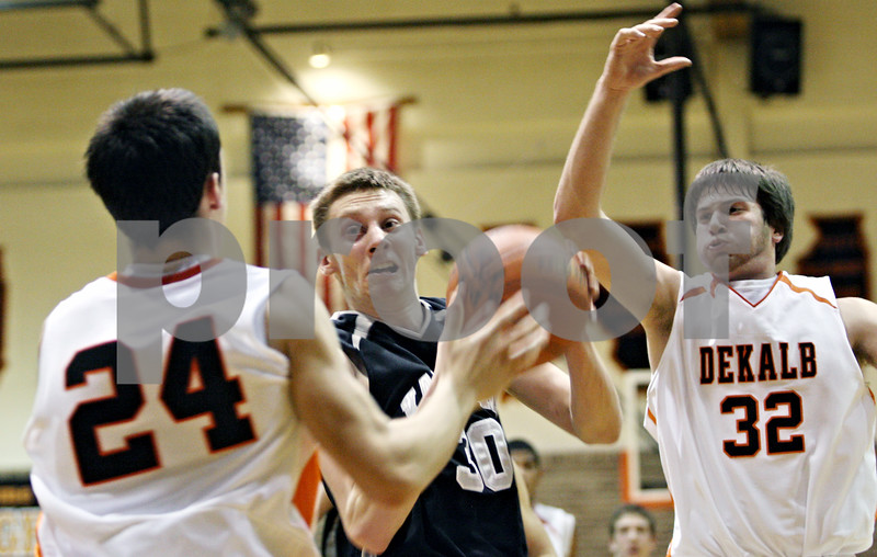 Rob Winner – rwinner@daily-chronicle.com<br /> <br /> Kaneland forward Chaon Denlinger controls a rebound under the Knights' basket in the fourth quarter in DeKalb, Ill. on Friday December 17, 2010. Kaneland defeated DeKalb in the final seconds, 49-47.<br /> <br /> **24 is DeKalb's Kyle Berg and 32 is Jake Jouris