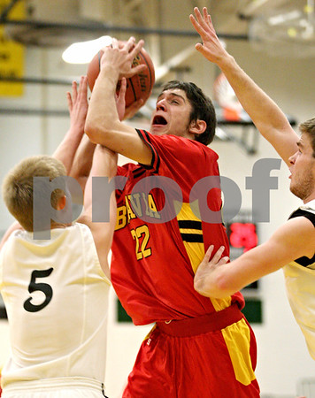 Rob Winner – rwinner@daily-chronicle.com<br /> Batavia's Ricky Clopton is fouled by Sycamore's Brendan Biffany (5) during the second quarter. Batavia defeated Sycamore on Friday February 19, 2010 in Sycamore, Ill., 68-63.
