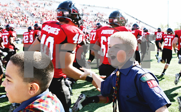 Rob Winner - rwinner@daily-chronicle.com<br /> <br /> Alex Wampler, of Lisbon, greets the NIU Huskies football team as they return to the field for the start of the third quarter in DeKalb, Ill. on Saturday October 9, 2010,