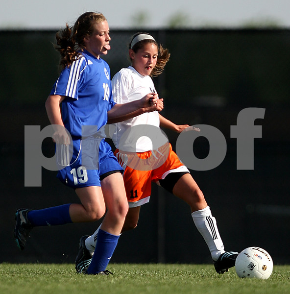Beck Diefenbach  -  bdiefenbach@daily-chronicle.com<br /> <br /> DeKalb's Gianna Pecoraro (11, right) and Burlington Central's Lindsey Puccio (19) battle for the ball during the second half of the game at Rochelle Township High School in Rochelle, Ill., on Tuesday May 18, 2010. DeKalb defeated Burlington Central 4 to 2.