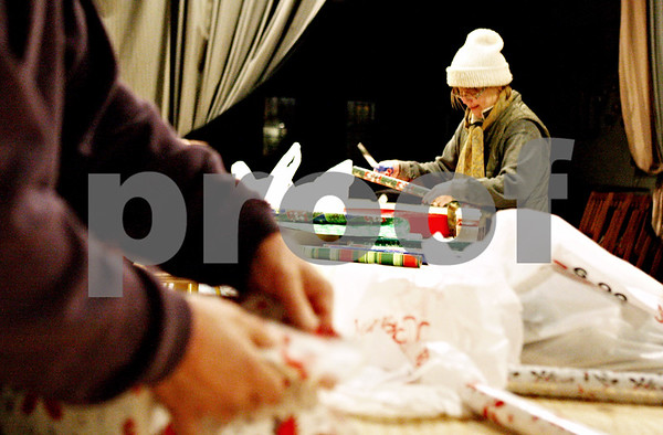 Rob Winner – rwinner@daily-chronicle.com<br /> <br /> On Tuesday night at Blumen Gardens in Sycamore, Nancy Mangan of Sycamore wraps gifts that will be distributed by the Goodfellows on Christmas Eve. Goodfellows is a volunteer group that delivers gifts to the needy during the holidays.