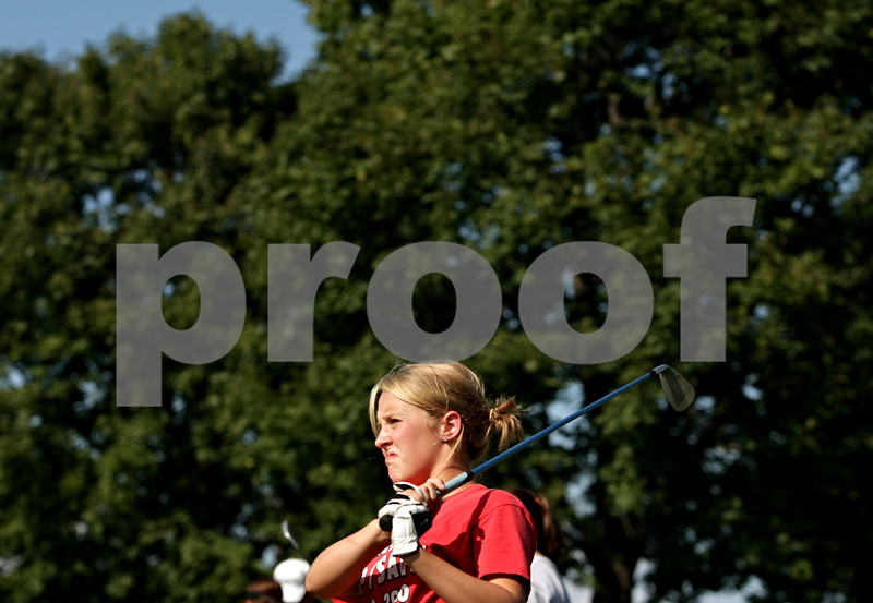 Beck Diefenbach - bdiefenbach@daily-chronicle.com<br /> <br /> Indian Creek junior Kalin Foster tacks her ball on the driving range during practice at the Indian Oaks Golf Course in Shabbona, Ill., on Wednesday Aug. 18, 2010.