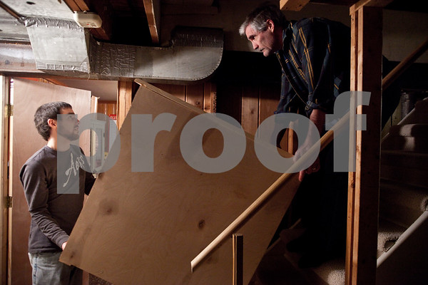 Beck Diefenbach – bdiefenbach@daily-chornicle.com<br /> <br /> Kevin, left, and his father David Ballantine carry the finished dresser upstairs from the basement the day before Kevin plans on leaving to return to New York on Jan 16, 2009.
