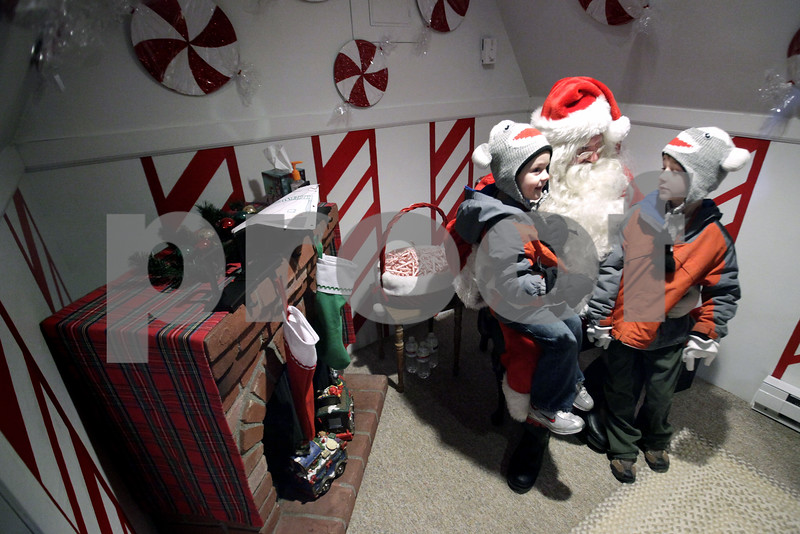 Kyle Bursaw – kbursaw@daily-chronicle.com<br /> <br /> Santa asks Thatcher and Roman Friedrichs want they want for Christmas in a small house on the corner of Locust and 2nd streets in DeKalb, Ill. on Thursday, Dec. 2, 2010.