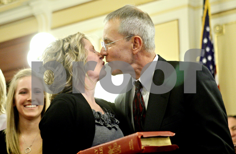 Rob Winner – rwinner@daily-chronicle.com<br /> <br /> After being sworn in as the 16th Circuit's newest judge,Tom Doherty (right) kisses his wife Jill at the DeKalb County Courthouse in Sycamore.