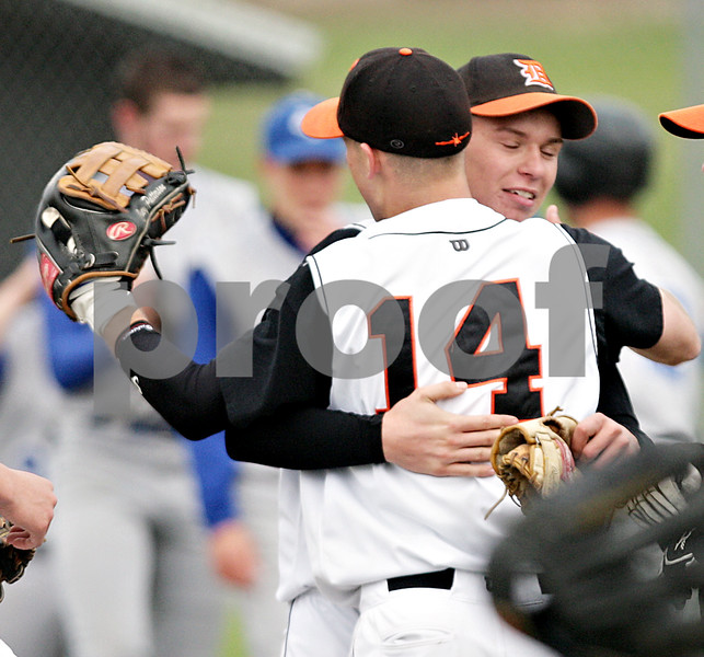 Beck Diefenbach  -  bdiefenbach@daily-chronicle.com<br /> <br /> DeKalb pitcher Cody Varga (11, right) is embraced by Frank Petras (14) after the final out clinches the win against Geneva at DeKalb High School in DeKalb, Ill., on Wednesday May 12, 2010. DeKalb defeated Geneva 4 to 3.