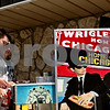 Beck Diefenbach  -  bdiefenbach@daily-chronicle.com<br /> <br /> Genoa-Kingston High School students Robert Sitar (far left) and Scott Hibbing get their free hot dogs from the Patriots Hot Dog stand in Malta, Ill., on Monday April 26, 2010. Sitar and Hibbing were among many students in the building trades class which received free hot dogs for completing the construction of the new Malta police department.