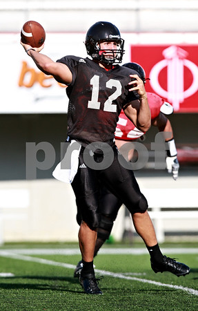 Beck Diefenbach  -  bdiefenbach@daily-chronicle.com<br /> <br /> Northern Illinois University's Chandler Harnish during practice at Huskie Stadium in DeKalb, Ill., on Wednesday Aug. 25, 2010.