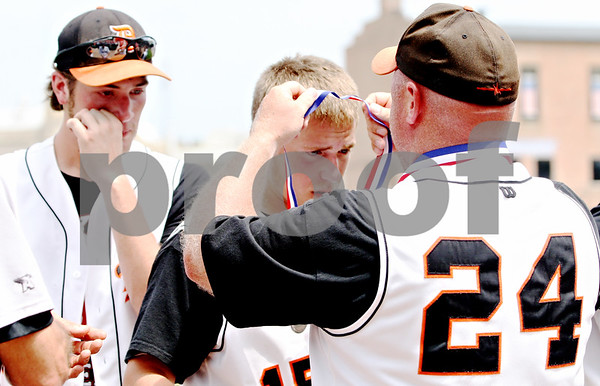 Rob Winner – rwinner@daily-chronicle.com<br /> <br /> DeKalb's Ben Dallesasse receives a second place medal at the end of the IHSA Class 3A championship in Joliet, Ill. on Saturday June 12, 2010. Chatham Glenwood defeated DeKalb, 11-1, in six innings.