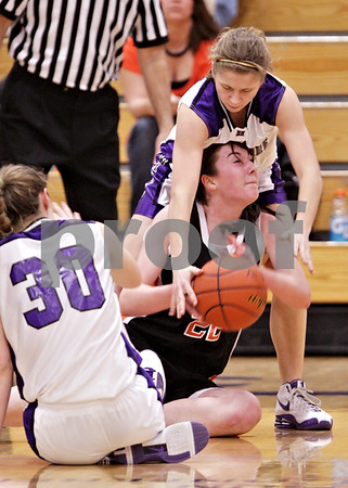 Beck Diefenbach  -  bdiefenbach@daily-chronicle.com<br /> <br /> Hampshire's Michelle Dumoulin (13, top) takes the ball away from DeKalb emily Bemis (22, center) during the third quarter of the IHSA Class 3A Regional championship game at Rochelle Township High School in Rochelle, Ill., on Thursday Feb. 18, 2010.