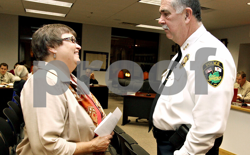 Wendy Kemp – For The Daily Chronicle<br /> <br /> Sycamore Chief of Police Donald Thomas (right) greets Diaconal Minister Judy Bergeson of Salem Lutheran Church before the Sycamore City Council meeting on Monday October 18, 2010 in Sycamore, Ill.