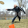 "Rob Winner – rwinner@daily-chronicle.com<br /> <br /> DeKalb County Disc Golf Club member Randy Moore Sr., of Oswego, takes a practice throw at Pioneer Park in Kirkland, Ill. on Saturday March 27, 2010. The club recognized outstanding members of their winter league, which ran from November to March, with ""thropies,"" made by Northern Illinois University glassblower Jason Gordon. The club's summer league begins April 2 and will meet every Friday at 5 p.m. For more information visit  <a href=""http://www.dcdisc.ning.com"">http://www.dcdisc.ning.com</a>."