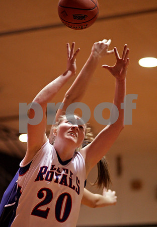 Beck Diefenbach – bdiefenbach@daily-chronicle.com<br /> <br /> Hinckley-Big Rock's Jenna Thorp reaches for a rebound during the fourth quarter of the IHSA Class 1A Regional playoff game against Westminster at Indian Creek High School in Shabbona, Ill., on Wednesday Feb. 10, 2010.