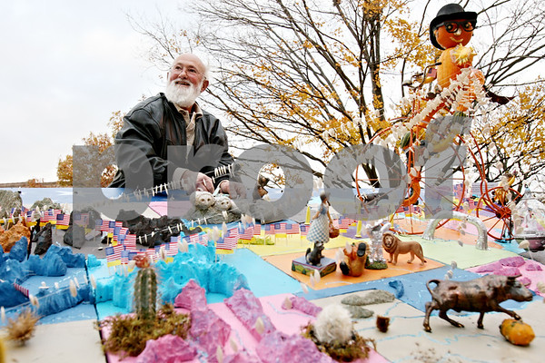Rob Winner – rwinner@daily-chronicle.com<br /> <br /> Lynden Bute of Sycamore puts the finishing touches on his entry for the 2010 Sycamore Pumpkin Festival in Sycamore, Ill. on Wednesday October 27, 2010.