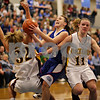 Beck Diefenbach - bdiefenbach@daily-chronicle.com<br /> <br /> Hinckley-Big Rock's Kaitlin Phillips (center) slides through Stockton's Morgan Werkheiser (32, left) and Jessica Burnner (11, right) during the second half of the the IHSA Class 1A Super Sectional championship game at Judson  University in Elgin, Ill., on Monday Feb. 22, 2010.