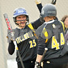 Beck Diefenbach  -  bdiefenbach@daily-chronicle.com<br /> <br /> Sycamore's Meranda Brashears (25, left) congratulates Kelcee Miller (44) after scoring a run during the third inning of the game against DeKalb at Sycamore High School in Sycamore, Ill., on Monday May 10, 2010.