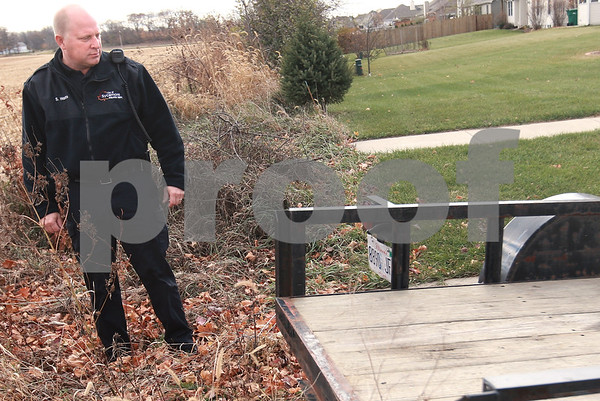 Kyle Bursaw - kbursaw@daily-chronicle.com<br /> <br /> New Sycamore community services police office Stephen Watts looks at the plate number of a trailer parked on a public street in Sycamore, Ill. on Nov. 5, 2010, to verify it is the same one he saw earlier in the week. His duties include handling ordinance issues, such as this.